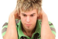 Hombre joven que mira abajo Fotografía de archivo libre de regalías