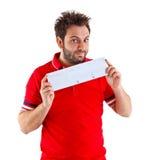 Hombre joven que muestra el giro postal italiano Fotos de archivo libres de regalías
