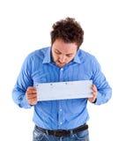 Hombre joven que muestra el giro postal italiano Foto de archivo libre de regalías