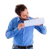 Hombre joven que muestra el giro postal italiano Fotografía de archivo libre de regalías