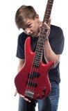 Hombre joven que muestra la guitarra baja Foto de archivo libre de regalías