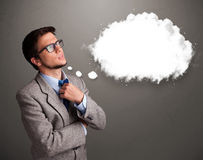 Hombre joven que piensa en discurso de la nube o burbuja del pensamiento con el poli Foto de archivo libre de regalías