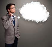 Hombre joven que piensa en discurso de la nube o burbuja del pensamiento con el poli Fotos de archivo