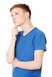 Hombre joven que piensa en un problema Imágenes de archivo libres de regalías