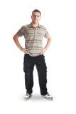 Hombre joven que presenta en ropa ocasional Foto de archivo