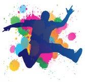 Hombre joven que salta contra un backgro de la salpicadura de la pintura stock de ilustración