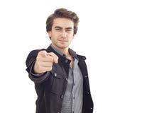 Hombre joven que señala en usted Foto de archivo