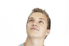 Hombre joven que soña despierto Foto de archivo libre de regalías