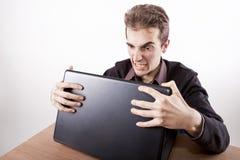 Muy enojado en el escritorio Fotos de archivo libres de regalías