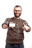 Hombre joven que sostiene un teléfono móvil Imágenes de archivo libres de regalías