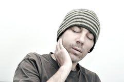 Hombre joven que sufre del dolor de muelas, dolor de dientes Fotografía de archivo libre de regalías