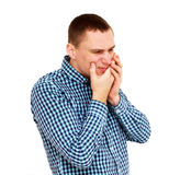 Hombre joven que tiene dolor de dientes Aislado en blanco Imágenes de archivo libres de regalías