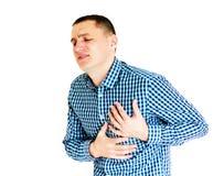 Hombre joven que tiene dolor del corazón Aislado en blanco Foto de archivo libre de regalías