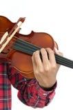 Hombre joven que toca el violín en fondo blanco aislado Imagen de archivo
