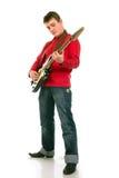 Hombre joven que toca la guitarra eléctrica Fotografía de archivo libre de regalías