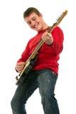 Hombre joven que toca la guitarra eléctrica Imagen de archivo