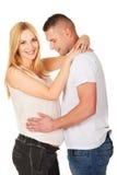 Hombre joven que toca su vientre del embarazo de la esposa Foto de archivo libre de regalías