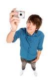 Hombre joven que toma cuadros Imagen de archivo libre de regalías