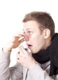 Hombre joven que toma el jarabe de la tos Fotografía de archivo libre de regalías