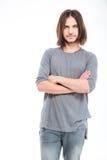 Hombre joven serio atractivo con el pelo largo Fotografía de archivo libre de regalías
