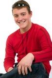 Hombre joven sonriente con las gafas de sol Imagen de archivo libre de regalías