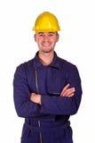 Hombre joven sonriente de la industria pesada Imagen de archivo libre de regalías