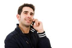 Hombre joven sonriente en el teléfono Foto de archivo libre de regalías