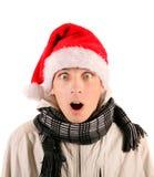 Hombre joven sorprendido en Santa Hat Imagenes de archivo