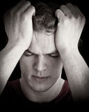 Hombre joven tensionado Imagen de archivo libre de regalías