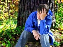 Hombre joven triste al aire libre Imagen de archivo