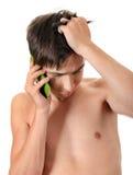 Hombre joven triste con el teléfono Imágenes de archivo libres de regalías