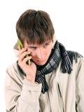 Hombre joven triste con el teléfono móvil Imagenes de archivo