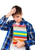 Hombre joven triste con libros Fotos de archivo libres de regalías