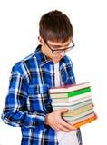 Hombre joven triste con libros Foto de archivo