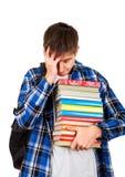 Hombre joven triste con libros Foto de archivo libre de regalías