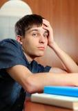 Hombre joven triste con los libros Fotos de archivo libres de regalías