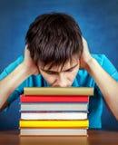 Hombre joven triste con los libros Imágenes de archivo libres de regalías