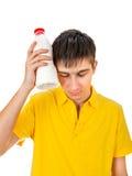 Hombre joven triste con una leche Fotografía de archivo