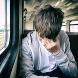 Hombre joven triste en el tren Foto de archivo