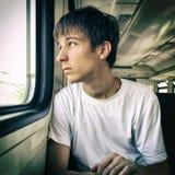 Hombre joven triste en el tren Imagenes de archivo