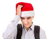 Hombre joven triste en Santa Hat Imagen de archivo