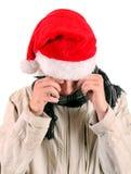 Hombre joven triste en Santa Hat Imagen de archivo libre de regalías