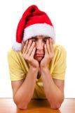 Hombre joven triste en Santa Hat Fotos de archivo