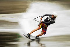 Hombre joven wakeboarding Foto de archivo libre de regalías