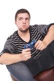 Hombre joven y furioso con una palanca de mando Foto de archivo