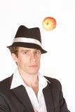 Hombre joven y manzana Fotografía de archivo libre de regalías