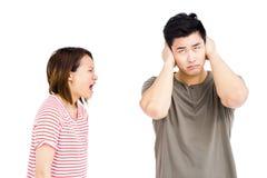 Hombre joven y mujer joven en una discusión fotos de archivo
