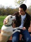 Hombre joven y perro Imagen de archivo libre de regalías
