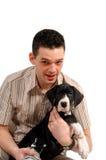 Hombre joven y su perrito Imagen de archivo libre de regalías
