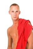 Hombre joven y toalla roja fotos de archivo libres de regalías